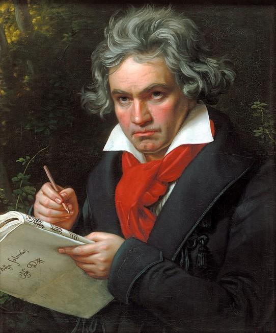 O óleo sobre tela de Joseph Stieler, de 1820, retrata o compositor Ludwig van Beethoven, em plano médio, segurando um lápis e uma partitura. Ele é um homem de pele clara, cabelos grisalhos cheios e crespos, desalinhados, sobrancelhas grossas e olhar penetrante, furinho no queixo. Ele usa casaco preto sobre camisa branca e lenço vermelho no pescoço. Com fisionomia séria, ele olha para esquerda. Ao fundo, folhagens.